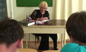 A handful of boys screw old granny teacher essentially the floor