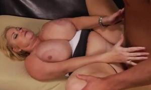 Beamy housewife with burly chest fucks younger dude on the couch
